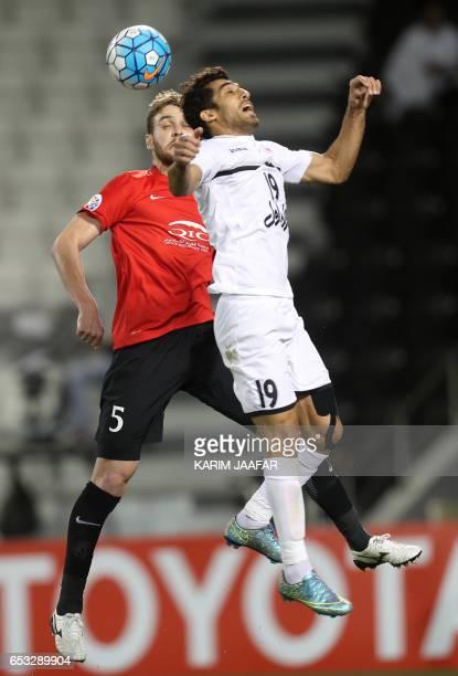 AlRayyan's Nathan Otavio Ribeiro fights for the ball against Persepolis' Vahid Amiri during the Asian Champions League football match between Qatar's...