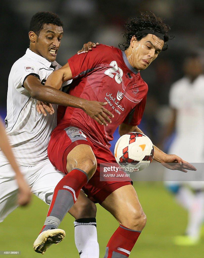 AlSadd's Ali AlMahdi vies for the ball against Lekhwiya's Sebastian Soria during their Qatar Stars League football match in Doha on December 11 2013...