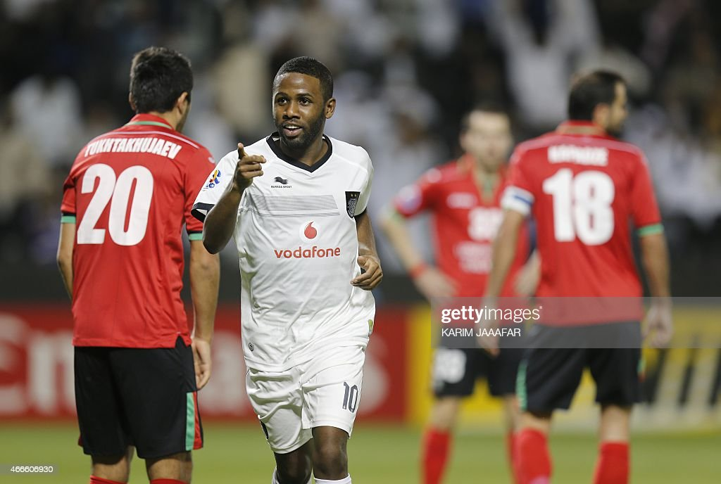 Al-Sadd's Khalfan Ibrahim (C) celebrates after scoring a goal during their AFC champions league Group C football match against Uzbekistan's Lokomotiv team at Jassim Bin Hamad Stadium in Doha on March 17, 2015. Al-Sadd won 6-2. AFP PHOTO / AL-WATAN DOHA / KARIM JAAFAR == QATAR OUT ==