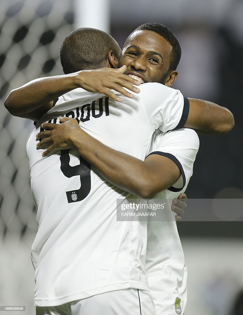 Al-Sadd's Khalfan Ibrahim (back) celebrates with his teammate Muriqui after scoring a goal during their AFC champions league Group C football match against Uzbekistan's Lokomotiv team at Jassim Bin Hamad Stadium in Doha on March 17, 2015. Al-Sadd won 6-2. AFP PHOTO / AL-WATAN DOHA / KARIM JAAFAR == QATAR OUT ==