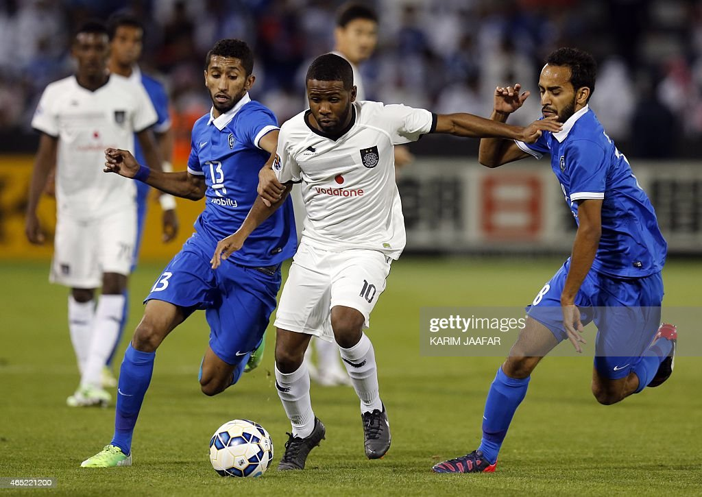 Al-Sadd's Khalfan Ibrahim (C) dribbles past Al-Hilal's Salman al-Faraj (L) and Abdullah Otayf (R) during the AFC champions league Group C football match Qatar's al-Sadd versus Saudi Arabia's al-Hilal at Jassim Bin Hamad Stadium in Doha on March 4, 2015. AFP PHOTO / AL-WATAN DOHA / KARIM JAAFAR == QATAR OUT ==