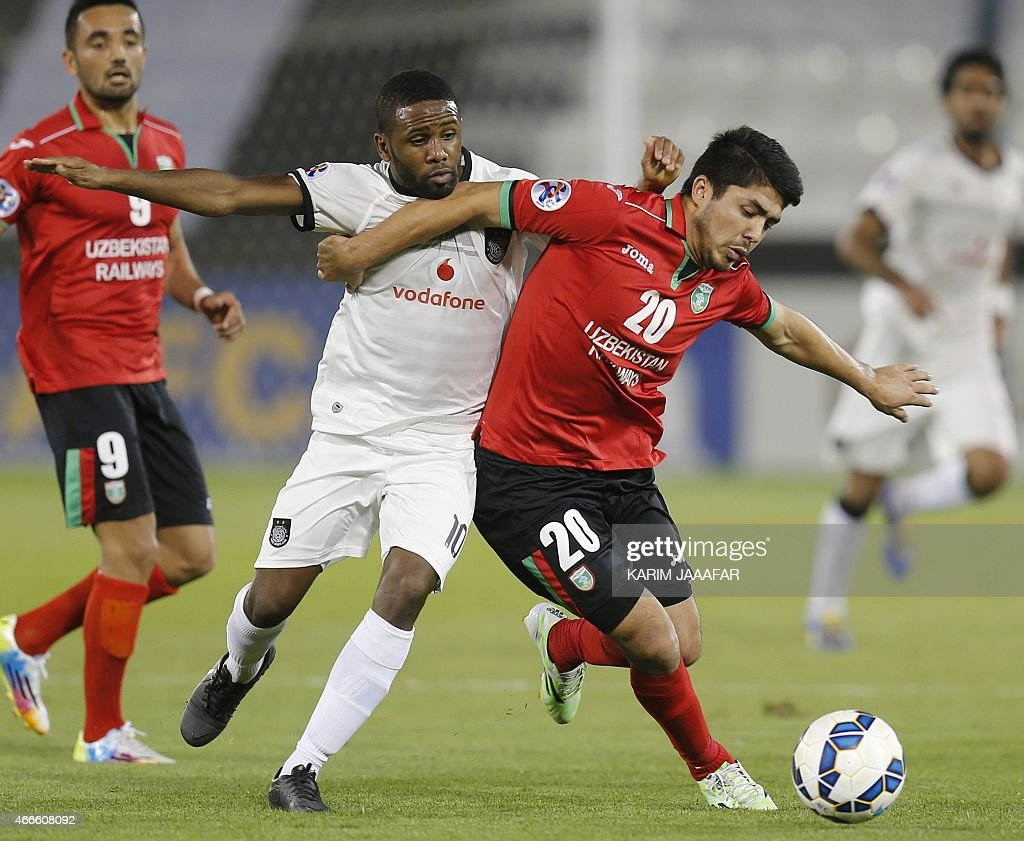 Al-Sadd's player Khalfan Ibrahim (L) vies for the ball against Islom Tuhtahujaev of Uzbekistan's Lokomotiv team during their AFC champions league Group C football match at the Jassim Bin Hamad Stadium in Doha on March 17, 2015. Al-Sadd won 6-2.