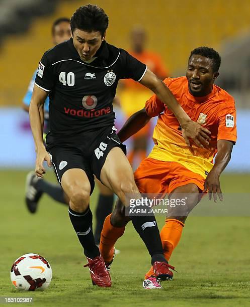 AlSadd's South Korean defender Lee JungSoo controls the ball ahead of Umm Salal's Ivorian forward Bakari Kone during their Qatar Stars League...
