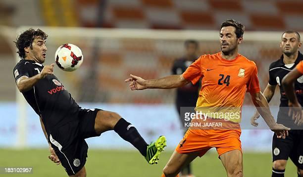 AlSadd's Spanish forward Raul controls the ball ahead of Umm Salal's Australian defender Sasa Ognenovski during their Qatar Stars League football...