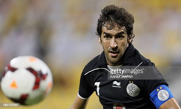 AlSadd's Spanish forward Raul eyes the ball during their Qatar Stars League football match against Umm Salal in Doha on October 4 2013 AFP PHOTO /...