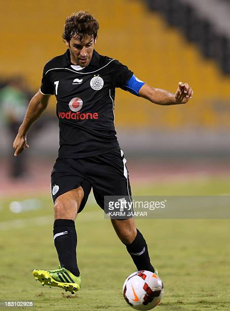 AlSadd's Spanish forward Raul passes the ball during their Qatar Stars League football match against Umm Salal in Doha on October 4 2013 AFP PHOTO /...