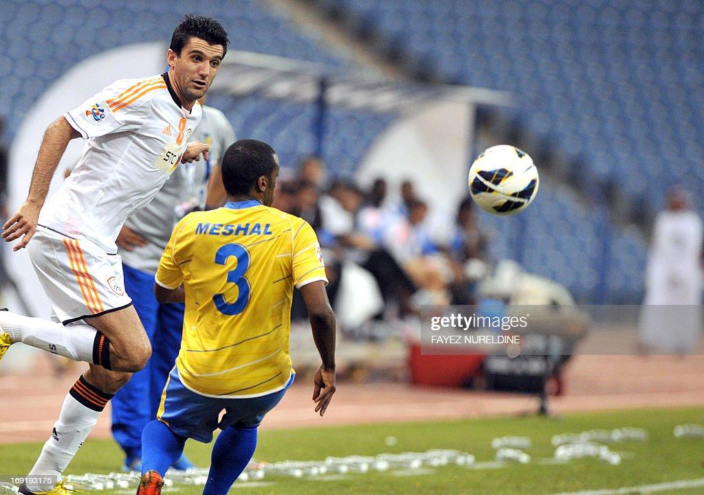 Al-Shabab player Fernando Menegazzo (L) dribble past Al-Gharafa Meshal Mubarak during their AFC Champions League football match at King Fahad International stadium in Riyadh, on May 21, 2013.