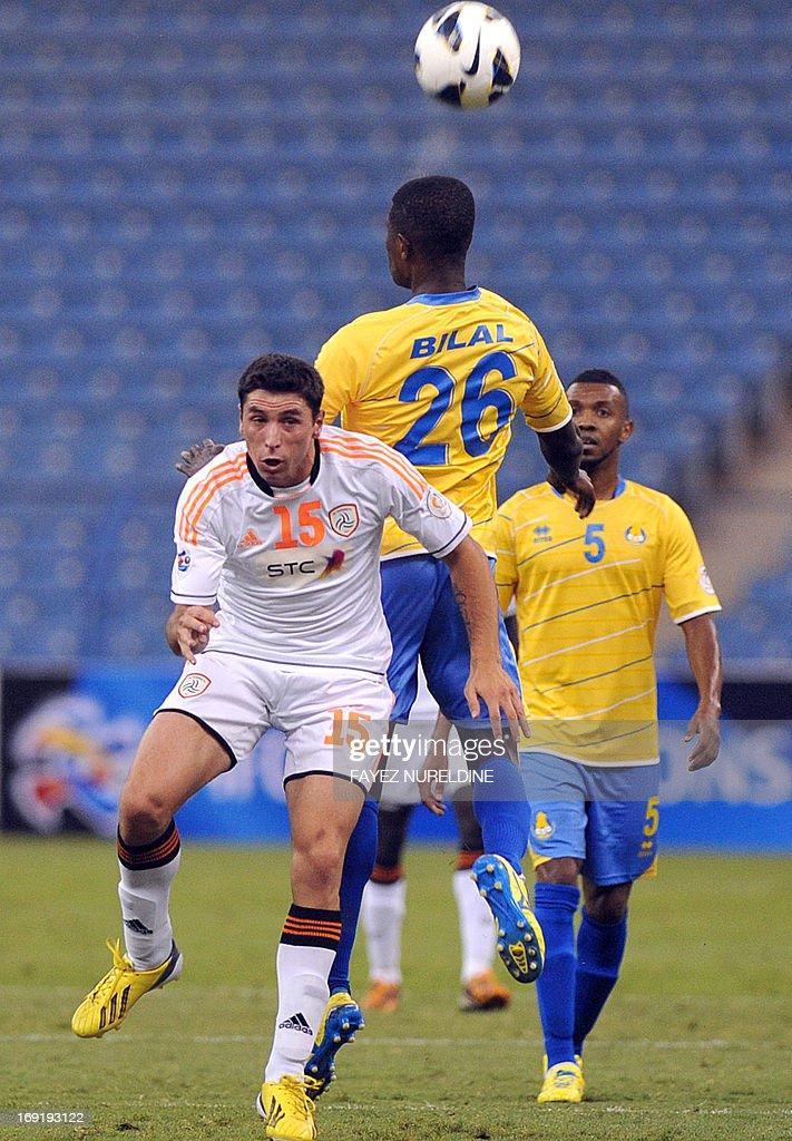 Al-Shabab player Sebastian Tagliabue (#15) vies for the ball with Al Gharafa Bilal Mohammed (#26) during their AFC Champions League football match at King Fahad International stadium in Riyadh, on May 21, 2013. AFP PHOTO/FAYEZ NURELDINE