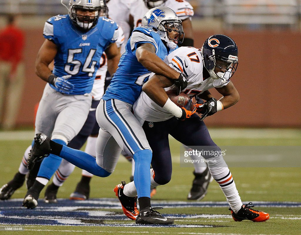 Alshon Jeffery #17 of the Chicago Bears battles for extra yards after a second quarter catch while being tackled by Pat Lee #27 of the Detroit Lions at Ford Field on December 30, 2012 in Detroit, Michigan.