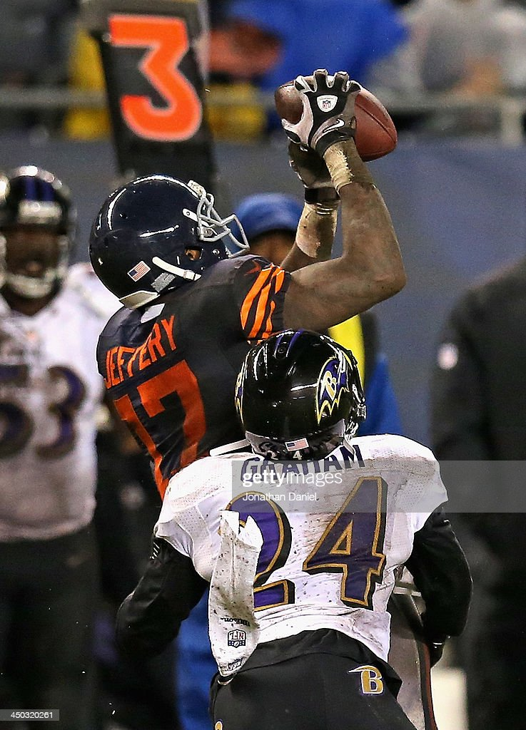 Alshon Jeffery #17 of the Chicago Bears catches a first down pass over Corey Graham #24 of the Baltimore Ravens at Soldier Field on November 17, 2013 in Chicago, Illinois. The Bears defeated the Ravens 23-20 in overtime.