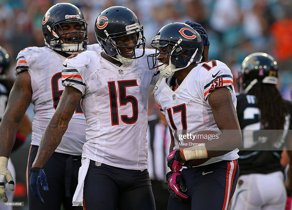 Alshon Jeffery #17 of the Chicago Bears is congratulated by Brandon Marshall #15 after scoring a touchdown during a game against the Jacksonville Jaguars at EverBank Field on October 7, 2012 in Jacksonville, Florida.