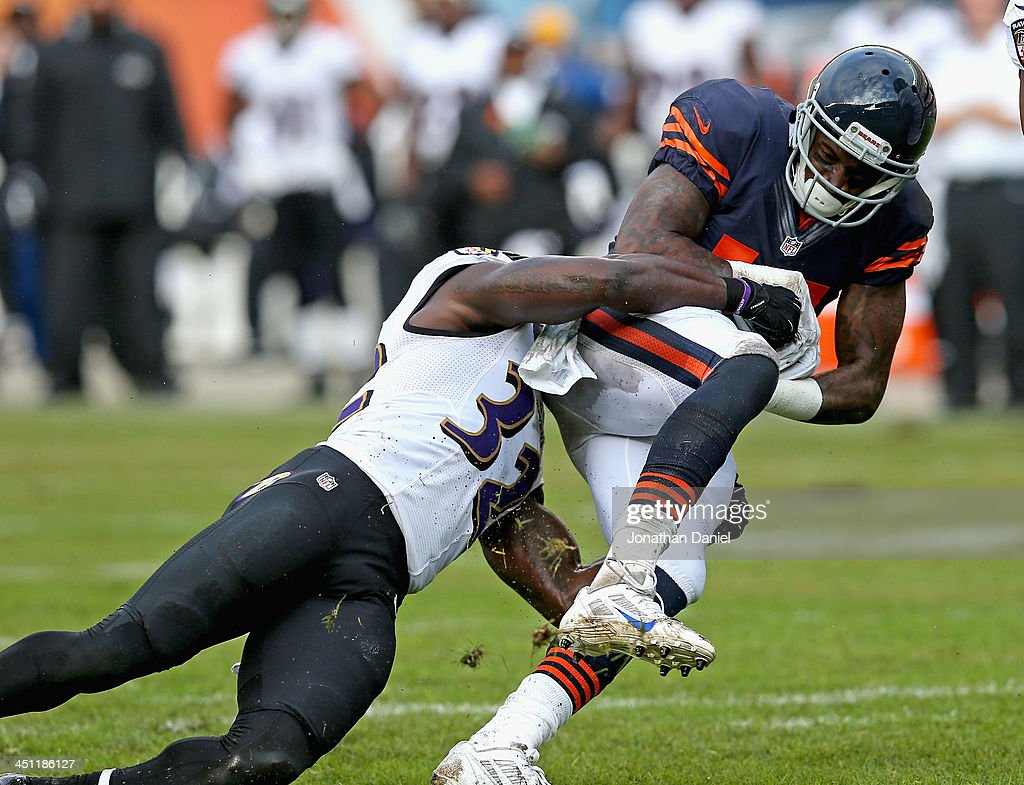 Alshon Jeffery #17 of the Chicago Bears is dropped by James Ihedigbo #32 of the Baltimore Ravens at Soldier Field on November 17, 2013 in Chicago, Illinois. The Bears defeated the Ravens 23-20 in overtime.