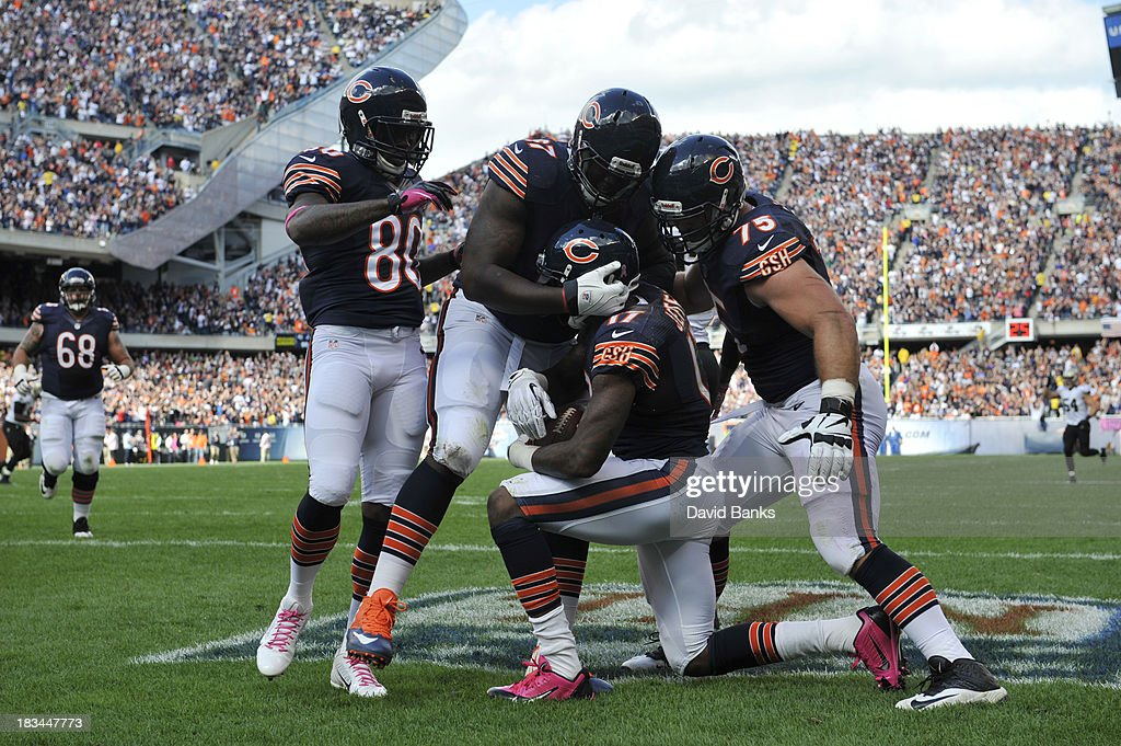 <a gi-track='captionPersonalityLinkClicked' href=/galleries/search?phrase=Alshon+Jeffery&family=editorial&specificpeople=6493995 ng-click='$event.stopPropagation()'>Alshon Jeffery</a> #17 of the Chicago Bears is greeted after catching a touchdown pass against the New Orleans Saints during the second quarter on October 6, 2013 at Soldier Field in Chicago, Illinois.