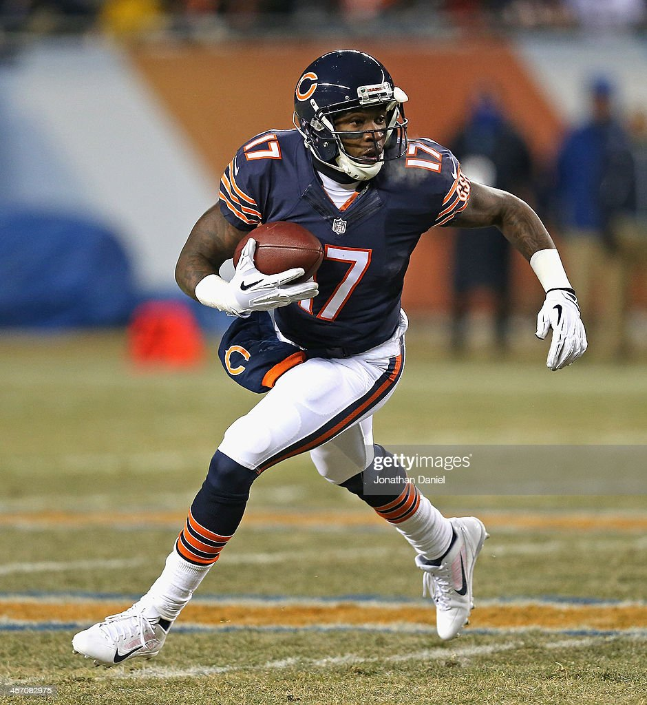 <a gi-track='captionPersonalityLinkClicked' href=/galleries/search?phrase=Alshon+Jeffery&family=editorial&specificpeople=6493995 ng-click='$event.stopPropagation()'>Alshon Jeffery</a> #17 of the Chicago Bears runs on an end-around against the Dallas Cowboys at Soldier Field on December 9, 2013 in Chicago, Illinois. The Bears defeated the Cowboys 45-28.