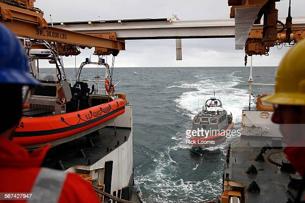 OTH–4 also known as an Over the Horizon Boat Mark 4 prepares to reunite with the Bertholf during a training mission in the Arctic waters off Barrow...