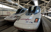 Alta Velocidad Espanola highspeed trains operated by RENFE wait for departure at Joaquin Sorolla railway station in Valencia Spain on Wednesday Jan...