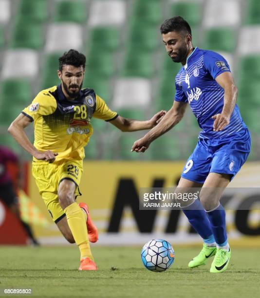 CORRECTION AlTaawoun's defender Abdullah Haif alShammari and Esteghlal's forward Kaveh Rezaei vie for the ball during their Asian Champions League...
