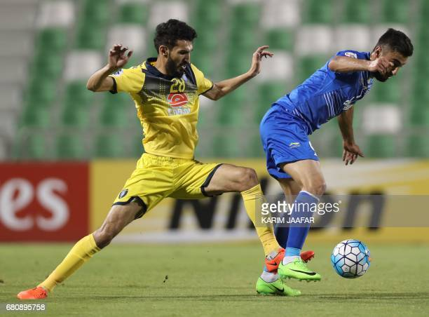 CORRECTION AlTaawoun's defender Abdullah Haif alShammari tackles Esteghlal's forward Kaveh Rezaei during their Asian Champions League football match...