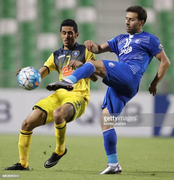 CORRECTION AlTaawoun's forward Mousa Salman alShammari and Esteghlal's forward Jaber Ansari vie for the ball during their Asian Champions League...
