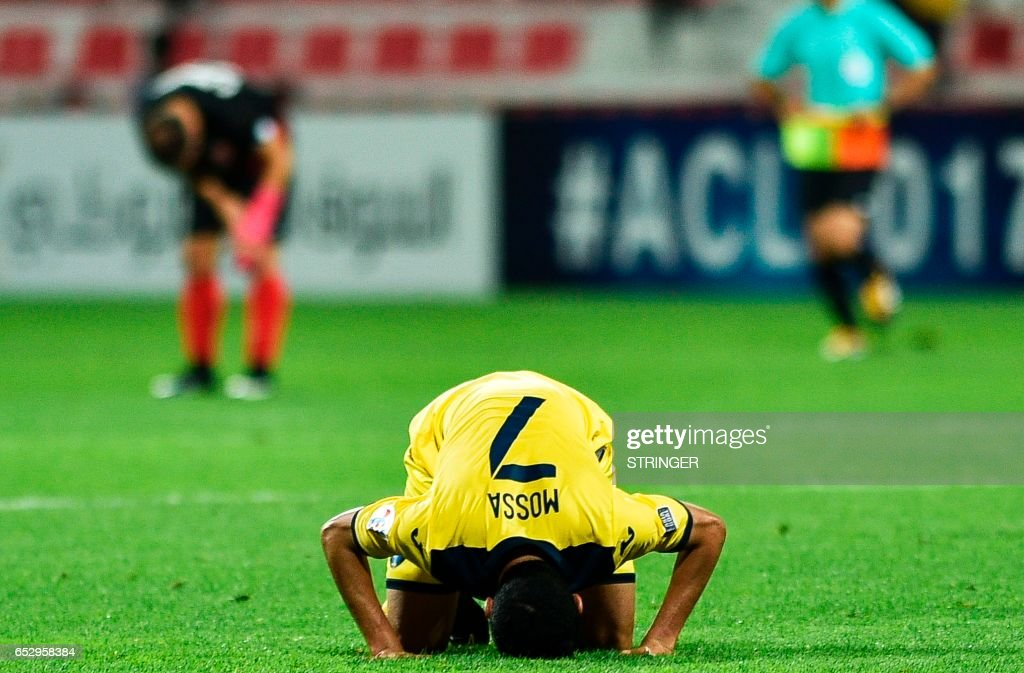 Al-Taawun's Mossa Salman al-Shammari react at the end of the AFC Champions League group stage football match between UAE's Al-Ahli and Saudi Arabia's Al-Taawun on March 13, 2017, at the Al-Rashid Stadium in Dubai. /