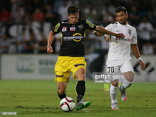 Altach's Andreas Lienhart with Guimaraes forward Toz in action during the UEFA Europa League Qualifier between Guimaraes and Altach at Estadio D...