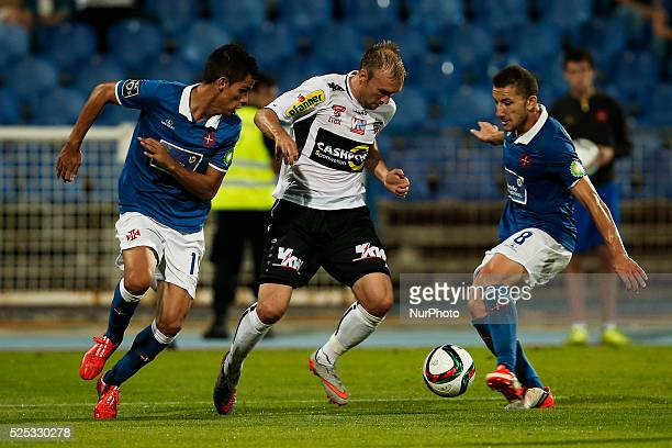 Altach's forward Patrick Seeger vies for the ball with Belenenses's defender Andre Geraldes and Belenenses's midfielder Andre Sousa during the UEFA...