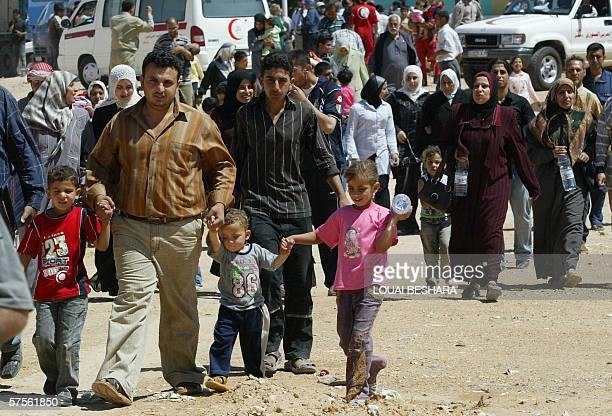 Palestinian refugees arrive in Syria from Iraq at the alTanaf border crossing 300 kms east of Damascus 09 May 2006 A group of 244 Palestinians...