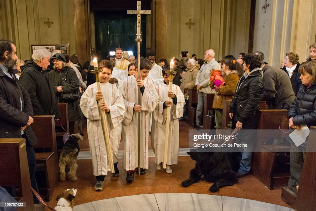 Altar boys enter the church as they begin a traditional mass for the blessing of animals at the Sant'Eusebio church on January 20, 2013 in Rome, Italy. Every year during the feast of St. Anthony the Abbot animals are blessed in countries around the world.