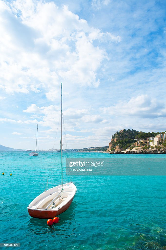 Altea Mediterranean sea detail with sailboat in alicante : Stock Photo