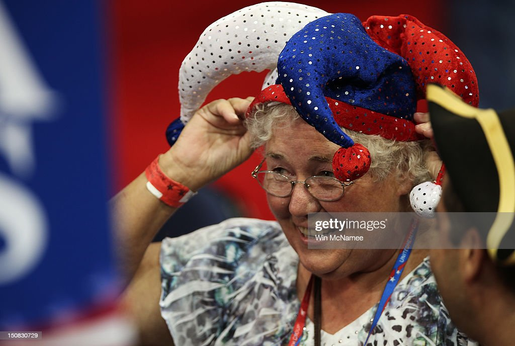 Alternate delegate Karen Skrill of Randolph, VT wears a jester hat on the arena floor before the start of the abbreviated first day of the Republican National Convention at the Tampa Bay Times Forum on August 27, 2012 in Tampa, Florida. The RNC is scheduled to convene today, but will hold its first full session tomorrow after being delayed due to Tropical Storm Isaac.