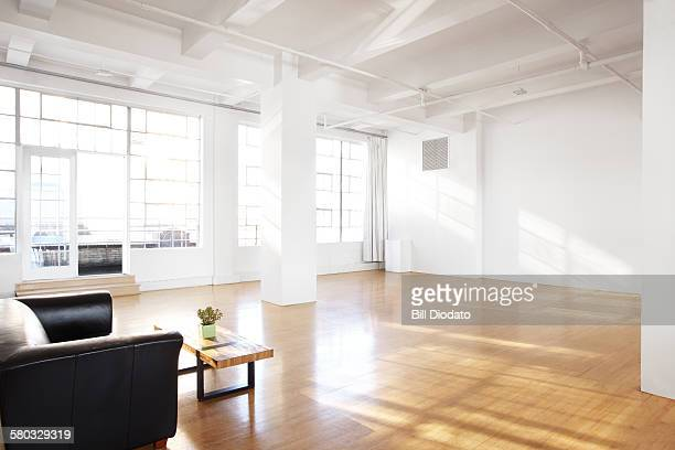 alternate view of large bare room with couch