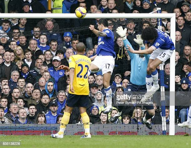 **Alternative Criop** Everton's Tim Cahill rises high to head home the opening goal of the game