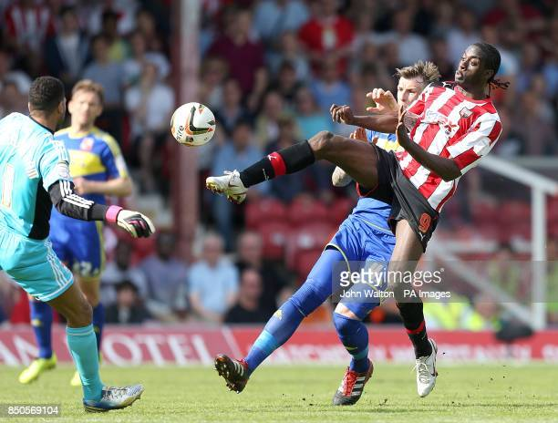 *Alternative Crop* Brentford's Clayton Donaldson goes for the ball ahead of Swindon Town goalkeeper Wes Foderingham