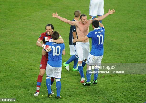 **Alternative Crop** Italy goalkeeper Gianluigi Buffon and Antonio Cassano celebrate with their team mates after the final whistle