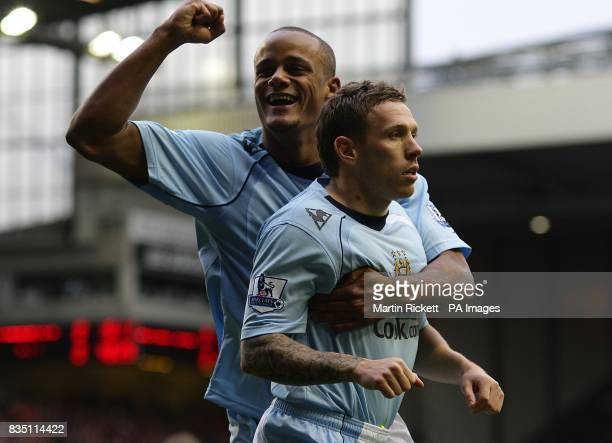 **Alternative Crop** Manchester City's Craig Bellamy celebrates with team mate Vincent Kompany after his shot on goal leads to Liverpool's Alvaro...