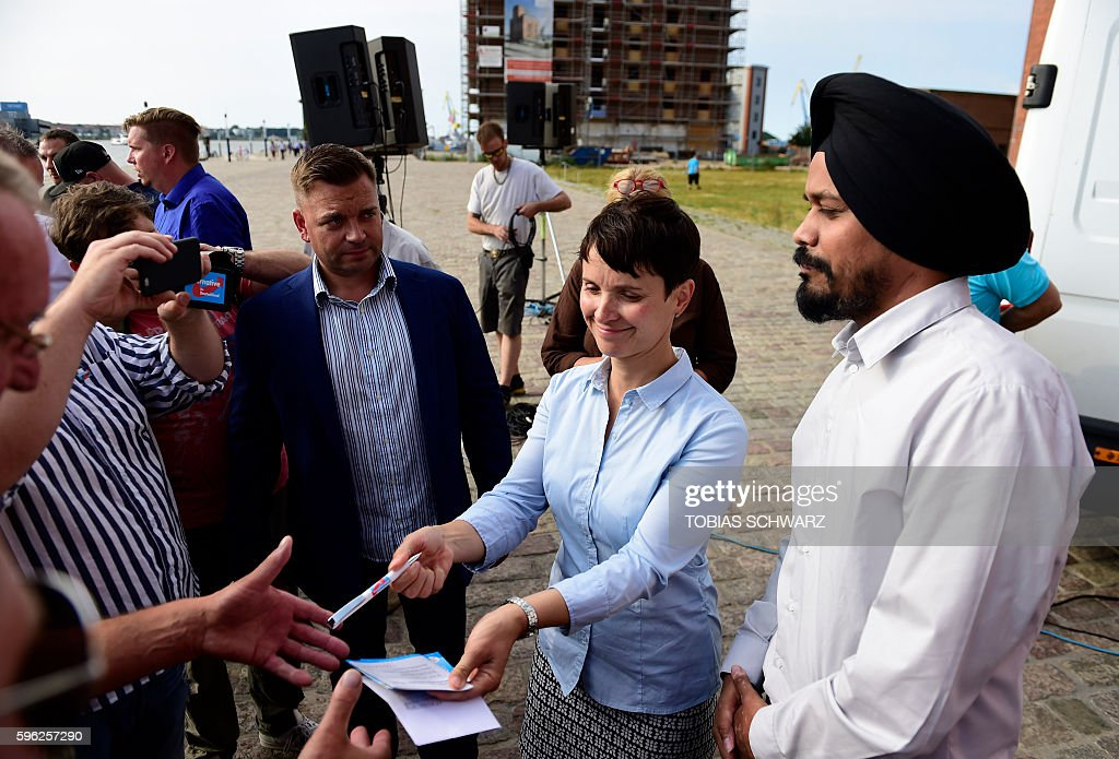 Alternative for Germany party chairwoman Frauke Petry signs autographs during an election campaign event in Wismar northeastern Germany on August 27...