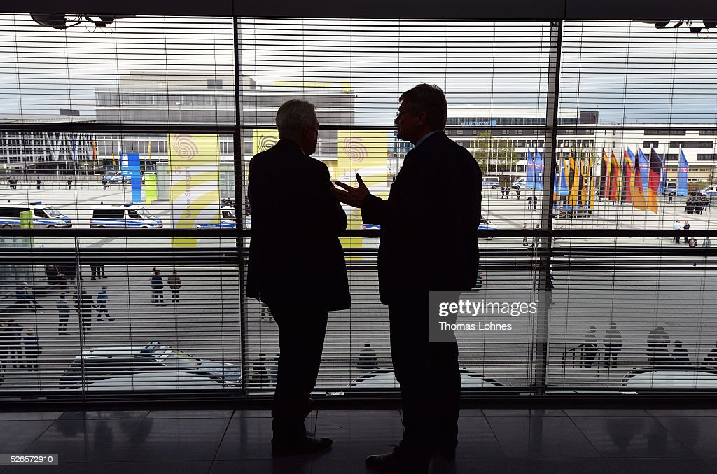 Alternative fuer Deutschland (AfD) co-leader Joerg Meuthen (R) and Guenter Brincker (L) diskuss at the party's federal congress while police car stand in front of the Stuttgart Congress Centre (ICS) on April 30, 2016 in Stuttgart, Germany. The AfD, a relative newcomer to the German political landscape, has emerged from Euro-sceptic conservatism towards a more right-wing leaning appeal based in large part on opposition to Germany's generous refugees and migrants policy. Since winning seats in March elections in three German state parliaments the party has sharpened its tone, calling for a ban on minarets and claiming that Islam does not belong in Germany.