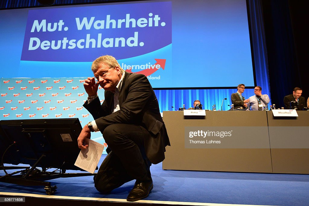 Alternative fuer Deutschland (AfD) co-leader Joerg Meuthen (R) holds a lettre of commitment of a left political group at he party's federal congress on May 01, 2016 in Stuttgart, Germany. A server of the party had been hacked by this left political group and the addresses of AfD members has been published. The AfD, a relative newcomer to the German political landscape, has emerged from Euro-sceptic conservatism towards a more right-wing leaning appeal based in large part on opposition to Germany's generous refugees and migrants policy. Since winning seats in March elections in three German state parliaments the party has sharpened its tone, calling for a ban on minarets and claiming that Islam does not belong in Germany.