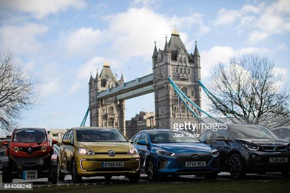 Alternativelyfuelled vehicles including hybrid plugin hybrid electric and hydrogen cars are displayed during a photocall by the Society Of Motor...