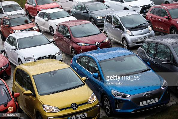 Alternativelyfuelled vehicles including hybrid plugin hybrid electric and hydrogen cars and vans are displayed during a photocall by the Society Of...