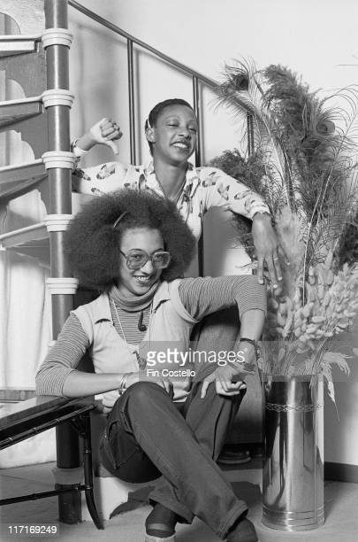 Althea Donna Jamaican reggae duo sitting on a spiral staircase posing for a portrait in London England Great Britain 1978