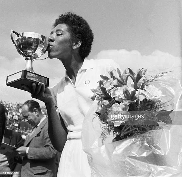 Althea Gibson kisses the cup she was rewarded with after having won the French International Tennis Championships in Paris