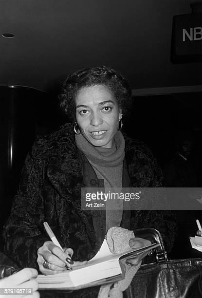 Althea Gibson signing a book circa 1970 New York