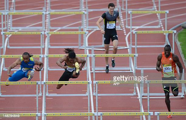 US althete Aries Merritt and US althete Jason Richardson jump hurdles as Britain's Andrew Pozzi stops after clipping a hurdle during the men's 110m...