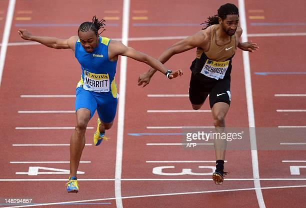US althete Aries Merritt dives for the line ahead of US althete Jason Richardson to win the men's 110m hurdles final at the 2012 Diamond League...