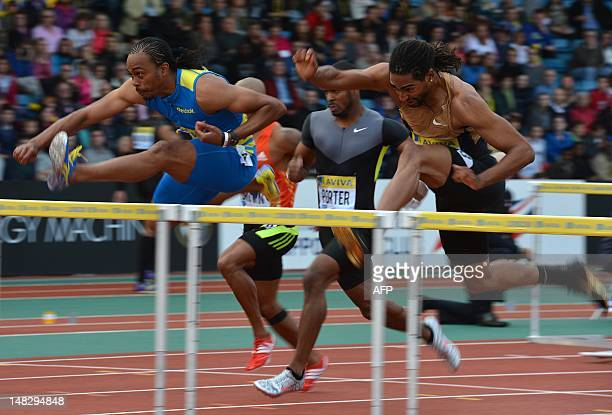 US althete Aries Merritt takes a hurdle to win ahead of US athlete Jeff Porter and US althete Jason Richardson in the men's 110m hurdles final at the...