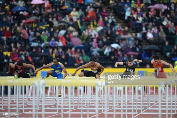 US althete Ryan Wilson US althete Aries Merritt US althete Jason Richardson Britain's Andrew Pozzi and China's Xie Wenjun compete in the men's 110m...