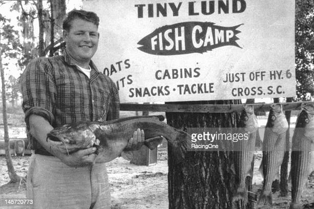 """Although a top driver in NASCAR Cup racing DeWayne """"Tiny"""" Lund who was """"tiny"""" only in name as he stood 6' 5"""" and weighed 270 lbs operated a fishing..."""