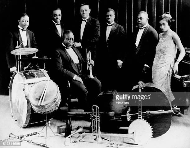 Although it only had a lifespan of four years King Oliver's Creole Jazz Band was one of the most influential early jazz bands Left to right the...