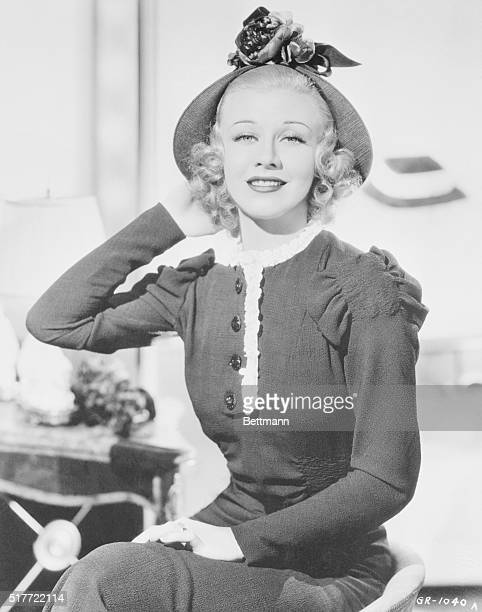 Although the brim starts out bravely on this hat worn by Ginger Rogers RKO star it completely dissappears by the time it reaches the center front...